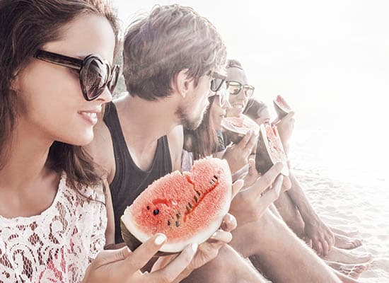 Eating watermelon with friends near Vue Oceanside