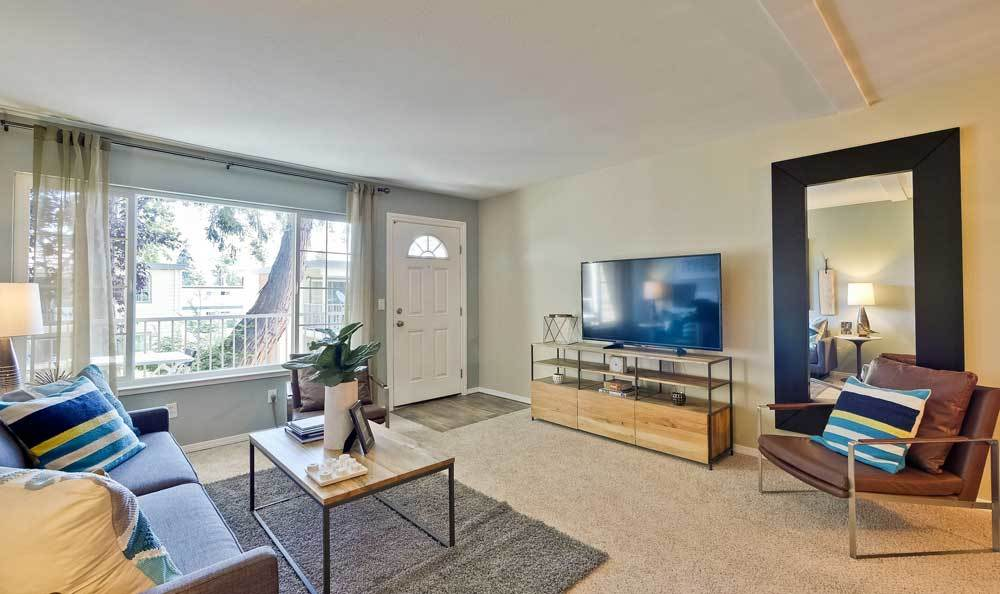 A living room that is great for entertaining at Sofi at Los Gatos Creek in San Jose, CA