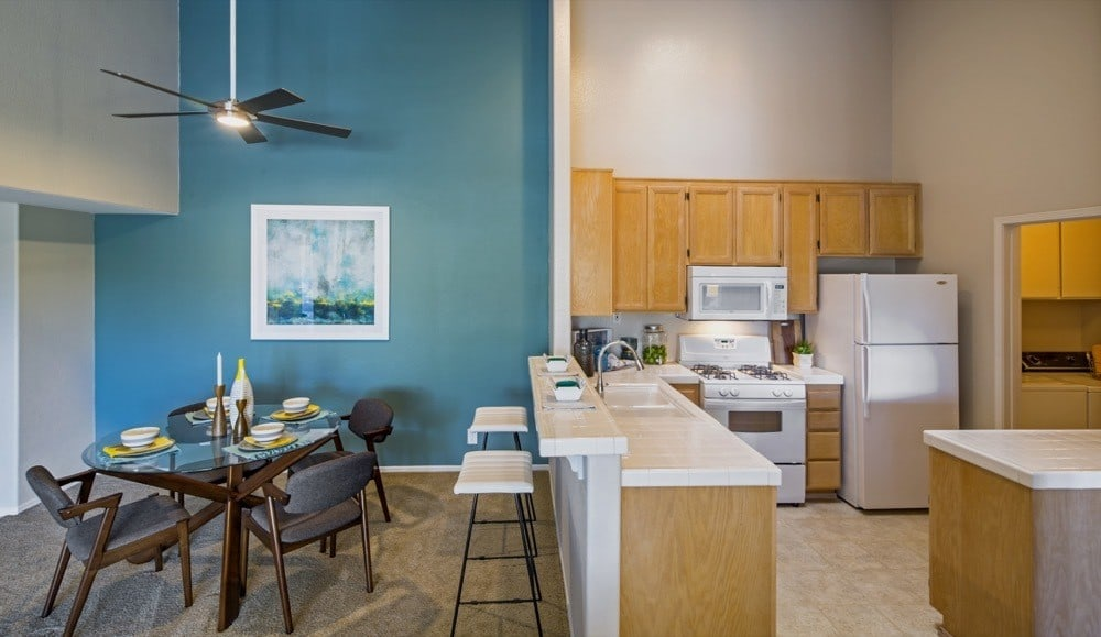 Beautiful kitchen and dining room at Sofi Canyon Hills in San Diego, CA