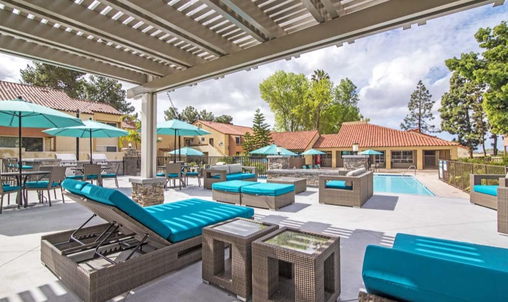 Pool furniture at apartments Verse in San Diego, CA