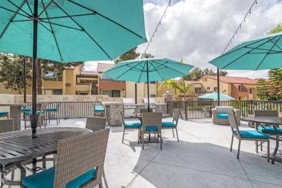 Pool Chairs and tables at apartments Verse in San Diego, CA