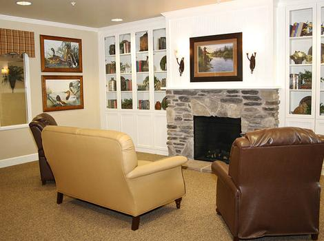 Living room with a fire place at Barathaven Alzheimer's Special Care Center