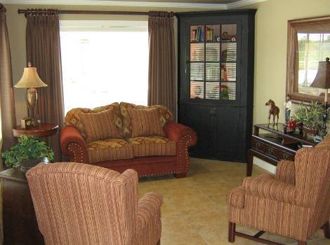 Spacious living room at Hudson Creek Alzheimer's Special Care Center in Bryan, TX