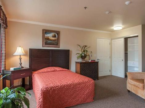 Well decorated bedroom in Maple Wood Alzheimer's Special Care Center