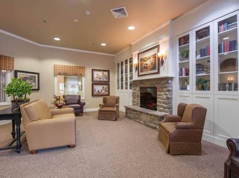 Gorgeous living room with a fireplace at Maple Wood Alzheimer's Special Care Center