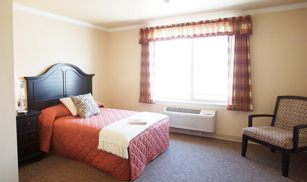 well decorated bedroom at North Ridge Alzheimer's Special Care Center in Albuquerque, NM