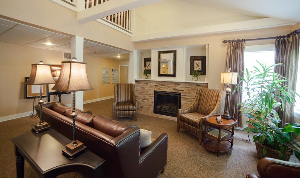 Warm up by the fireplace at senior living in Tumwater