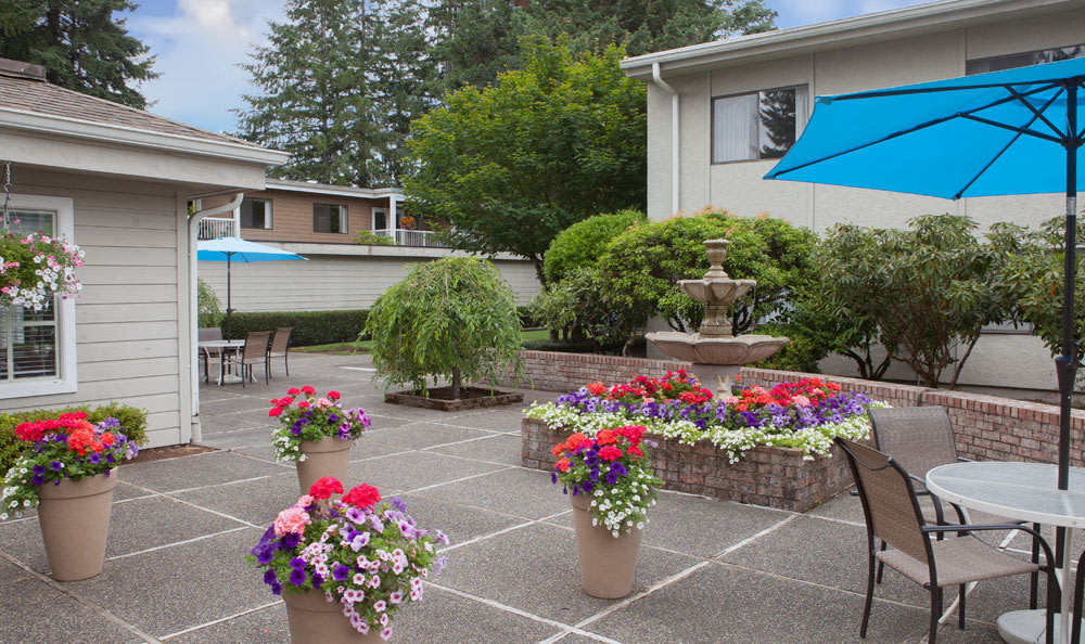 The patio at Olympics West Retirement Inn is covered in flowers!