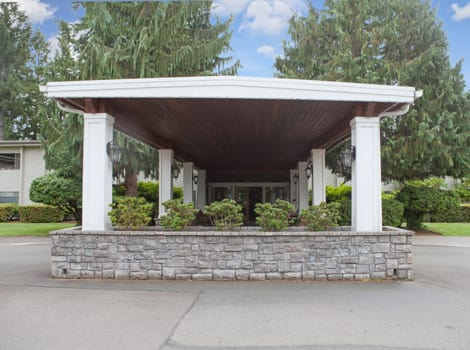 Welcoming entrance to Olympics West Retirement Inn