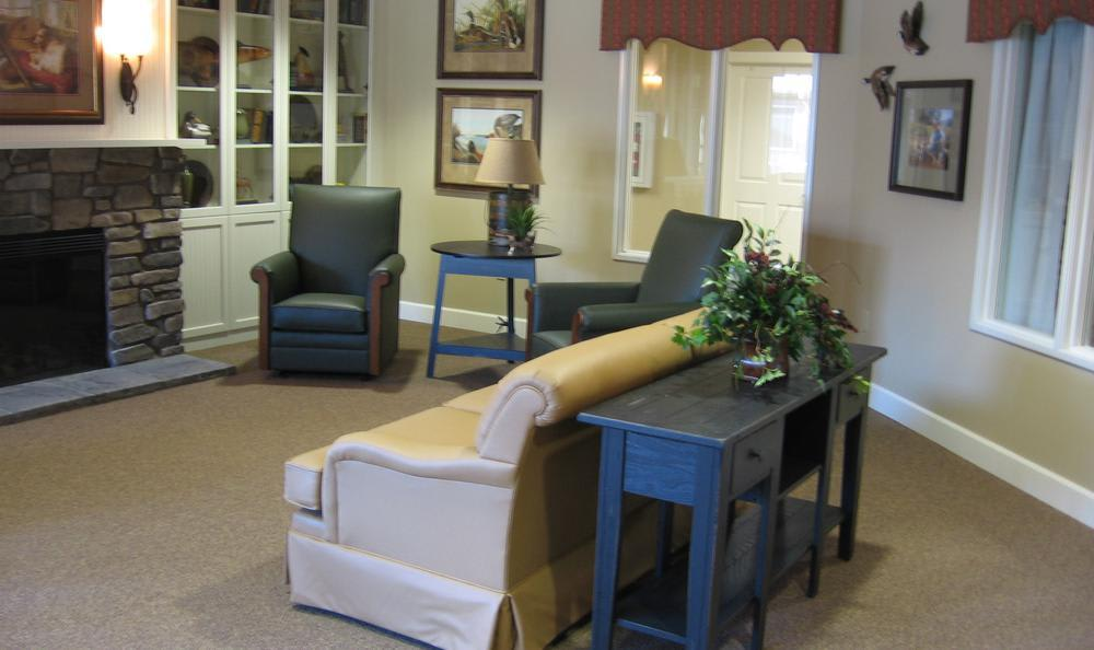 clubhouse living room with chimney at Pine Ridge Alzheimer's Special Care Center in Spokane Valley, WA