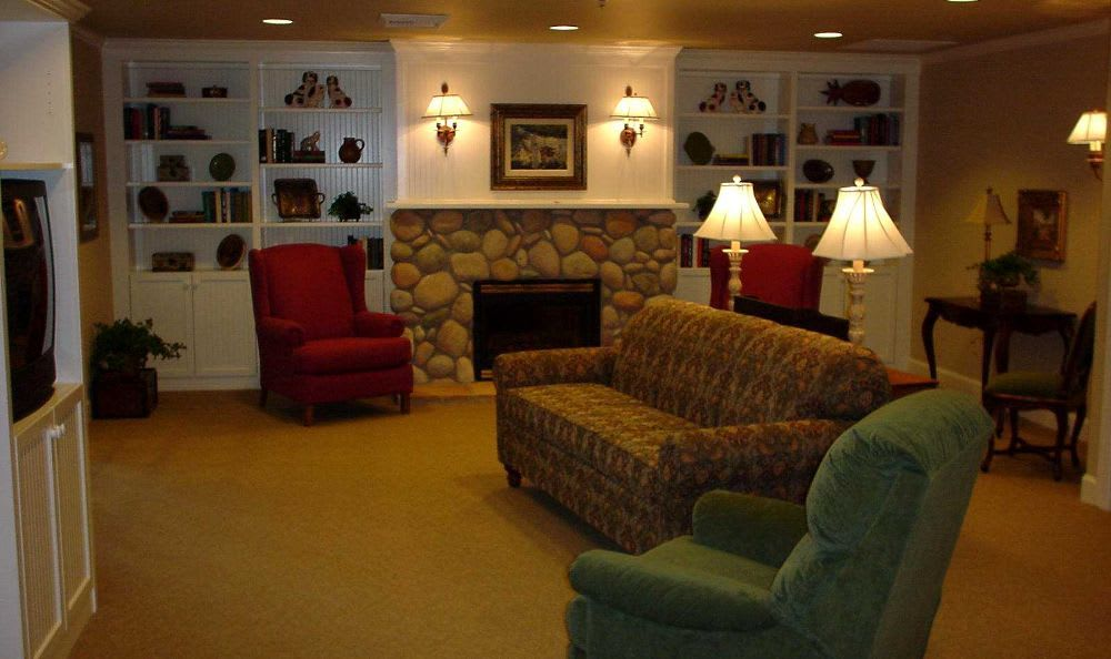 living room with chimney at Summer Wood Alzheimer's Special Care Center in Moses Lake, WA