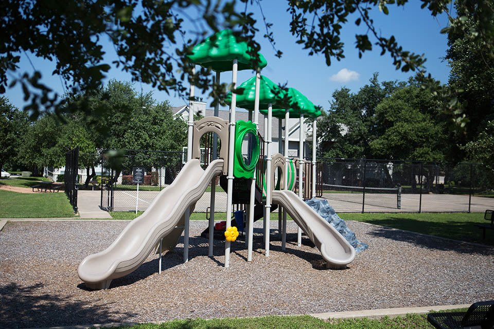 The playground near apartments at The Bridge at Volente