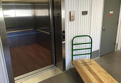 Another view of the secure elevator here at Frederica Storage, with one of our dollies that are free for tenants to use!