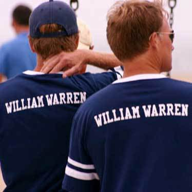 William Warren Group, two guys in baseball shirts