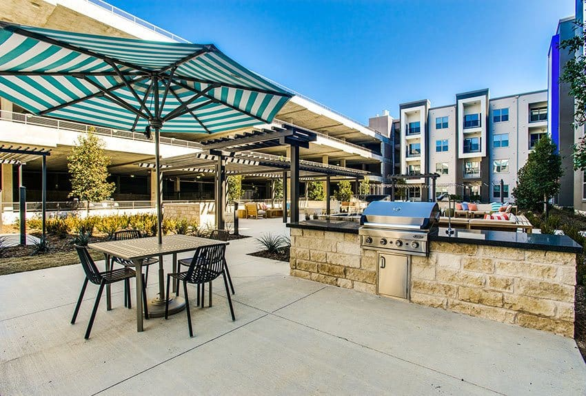 There's plenty of comfortable seating in the pool area at Maple District Lofts, as well as BBQ grills for entertaining friends and family!