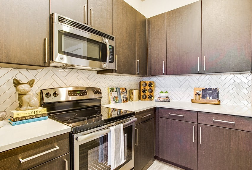The modern kitchens at Maple District Lofts are full of all the conveniences you need to cook fantastic meals.