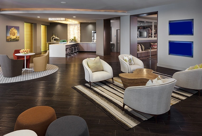 The clubhouse at Maple District Lofts is spacious, luxurious, and filled with everything you need to entertain guests.