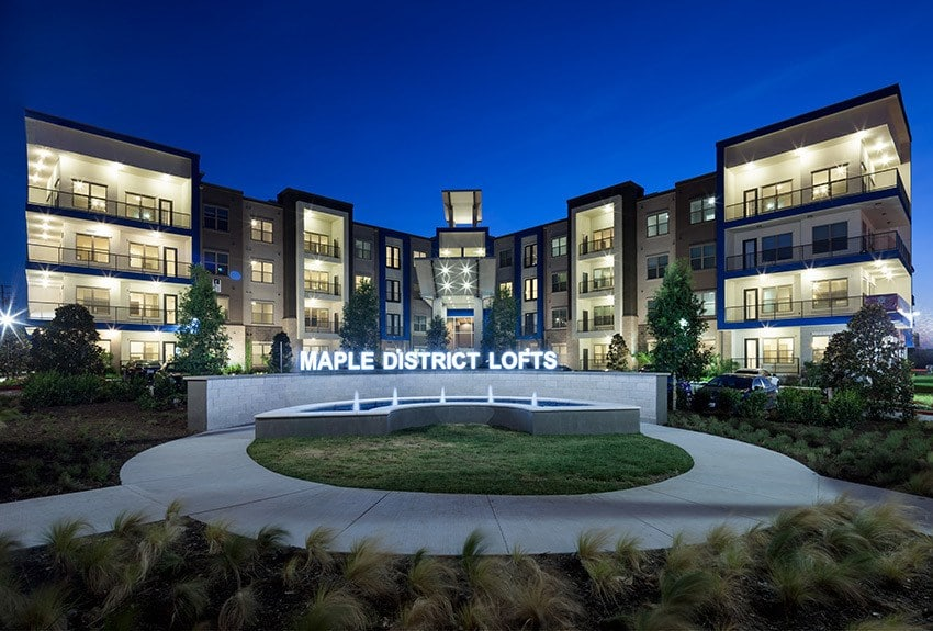 Evening view of Maple District Lofts in Dallas, TX.