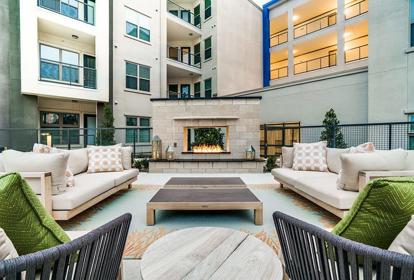 Lounge poolside with your friends and neighbors at our luxury apartment community at Maple District Lofts in Dallas.