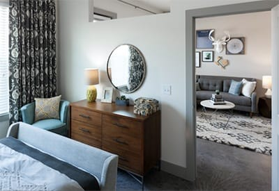 The bedrooms in our luxury apartment homes at Maple District Lofts are spacious, warm, and inviting.