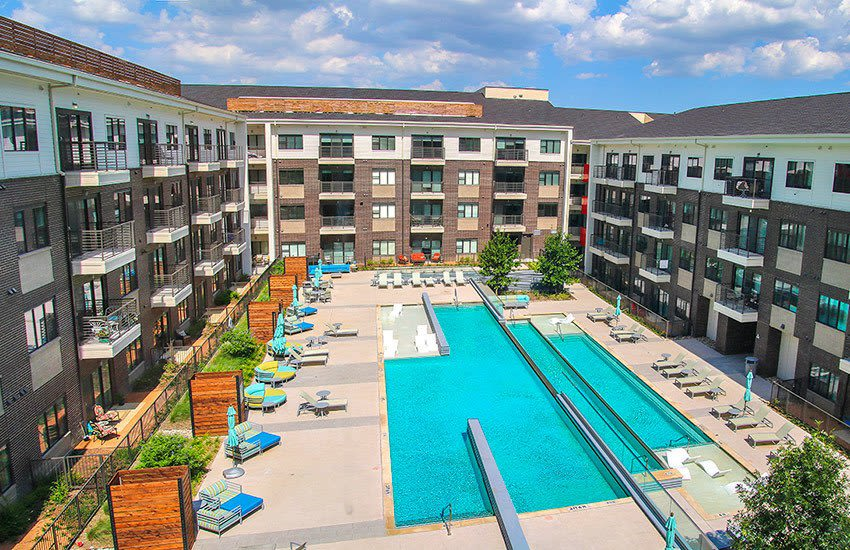 Aerial view of the expansive and luxurious swimming pool area at Axis 3700 in Plano.