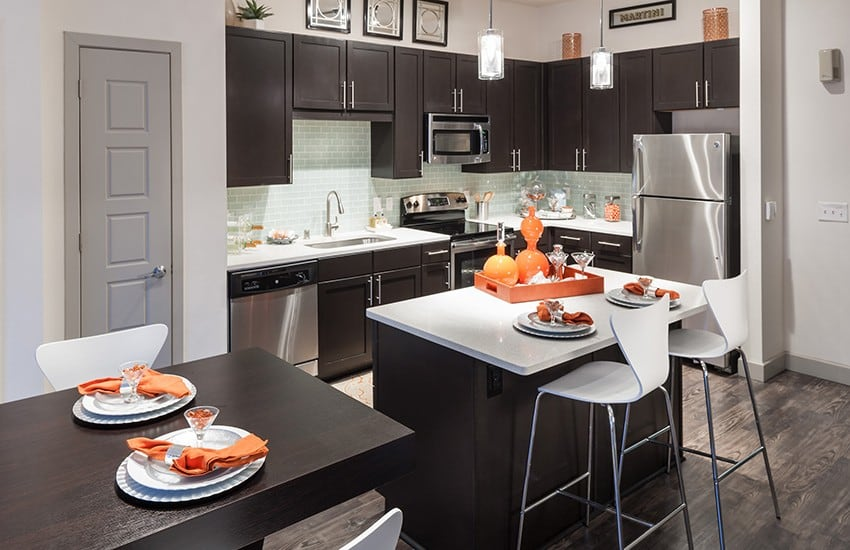 The kitchen in your new apartment home at Axis 3700 is loaded with modern conveniences.