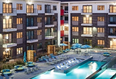 Evening view of the pool area at Axis 3700 luxury apartments in Plano.