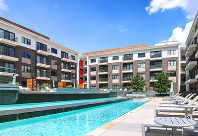 Our sparkling swimming pool on a beautiful day at Axis 3700 in Plano.