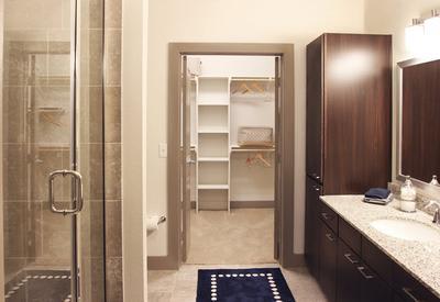 Model bathroom at Axis at The Rim