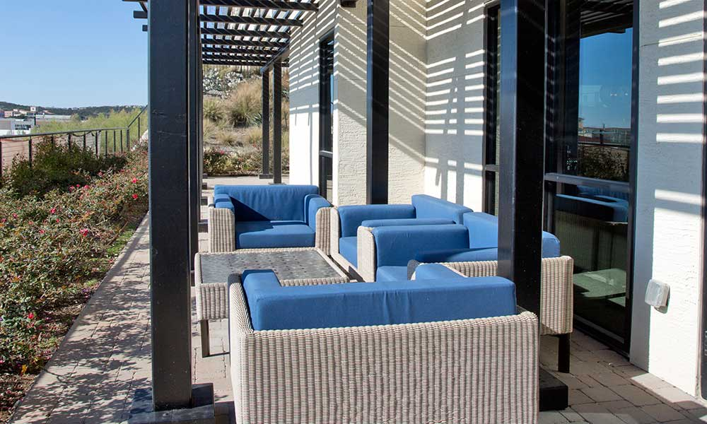 Soak up the sun on the patio by the clubhouse at Axis at The Rim