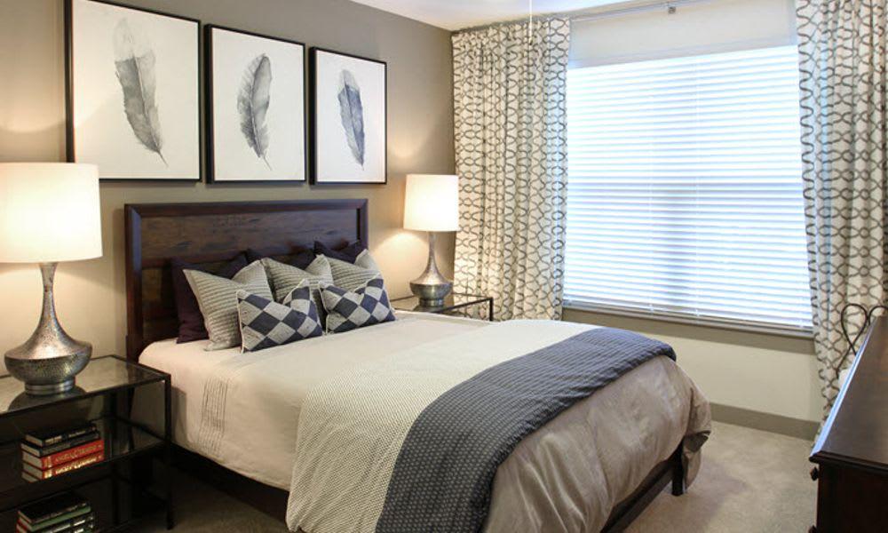 Model bedroom at Axis at The Rim