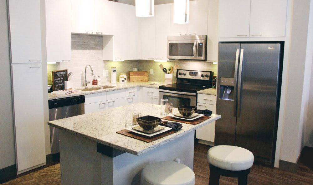 Another Apartment Kitchen at Axis at Wycliff in Dallas, TX