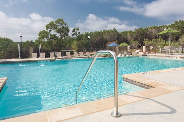 Resort Style Pool With Water Feature At Our Austin Apartments