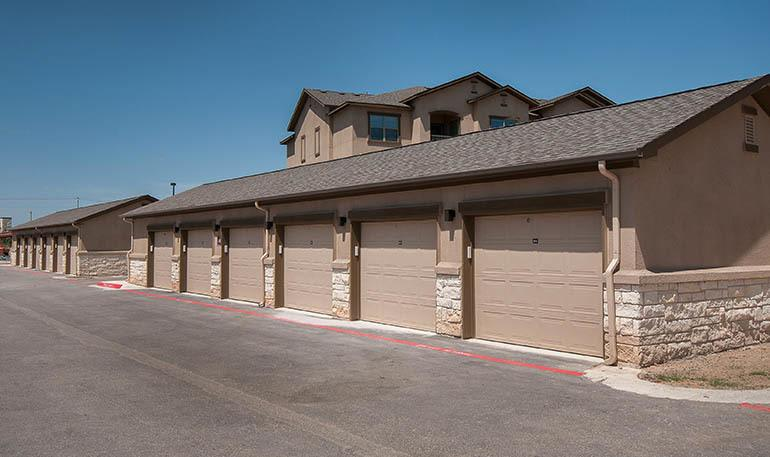 Apartment garages at Carrington Oaks in Buda, TX