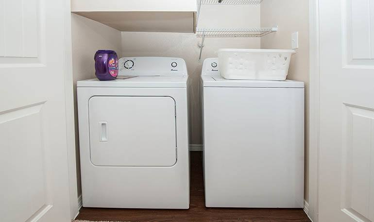 Laundry room inside apartments at Carrington Oaks