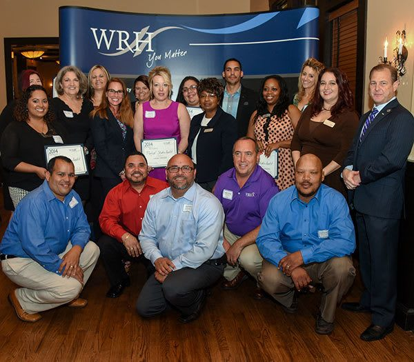 Happy employees at WRH Realty Services, Inc