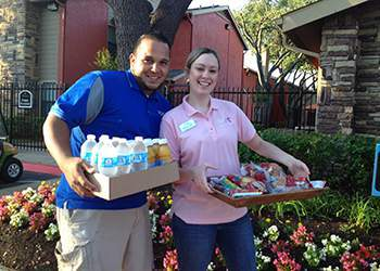 WRH Realty Services, Inc Donating Food to a charity