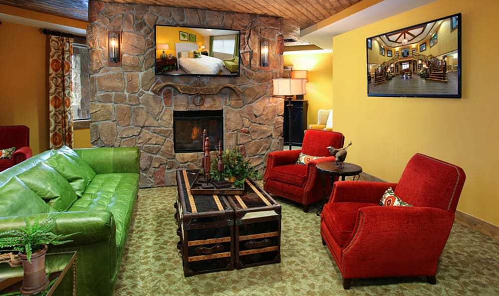 Senior living resident lounge with fireplace at American House Wildwood in Wildwood, FL