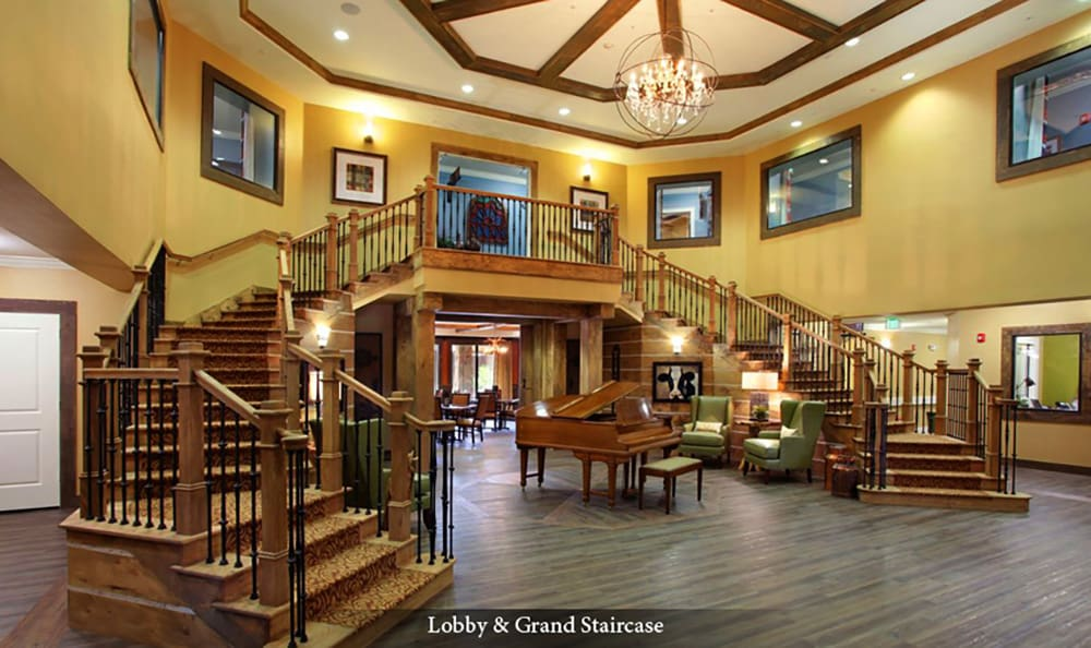 Entry grand staircase at American House Wildwood