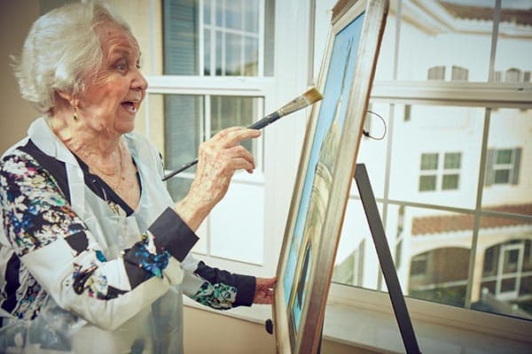 Woman painting at our senior living community