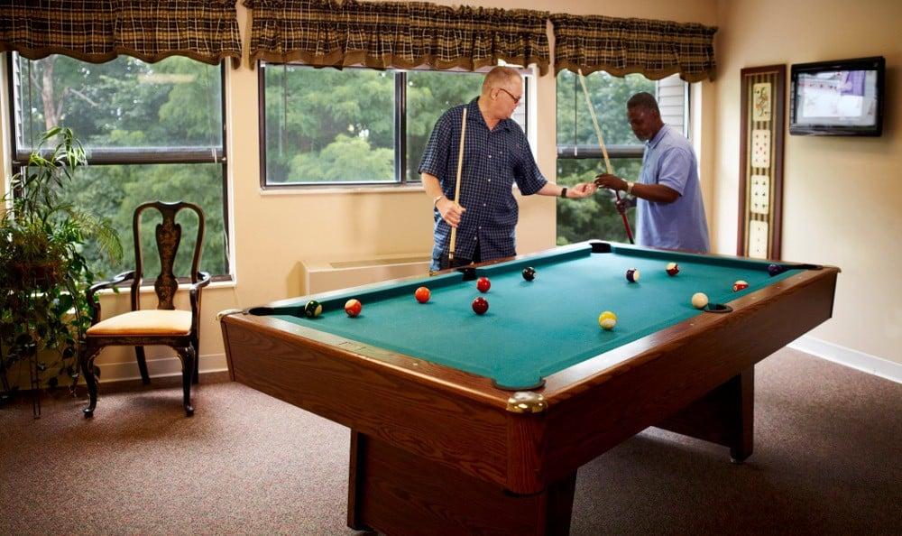 Friends Enjoying Billiards At Senior Living In Ypsilanti MI