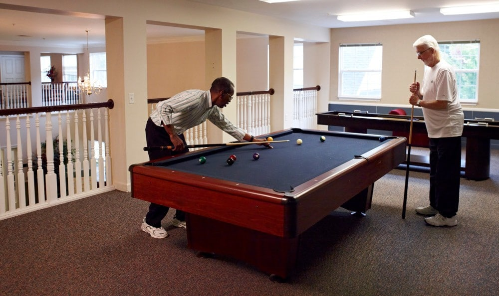 Friends Enjoying Billiards At Senior Living in Flint, MI