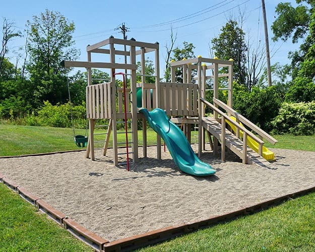 View our list of Community Amenities including a playground at Four Seasons Apartments