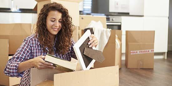 Woman unpacking her home after a move.