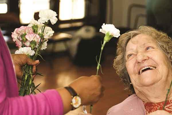 Memory Care resident at The Trace with flowers