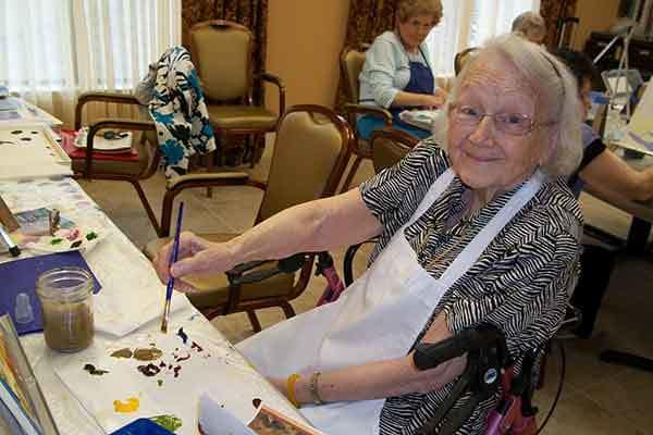 Resident at The Trace enjoys a painting class