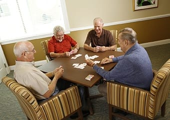 Senior living residents in Pennsylvania play cards together