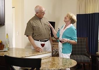 Senior living residents celebrate making the smart financial choice at Aston Gardens At Parkland Commons