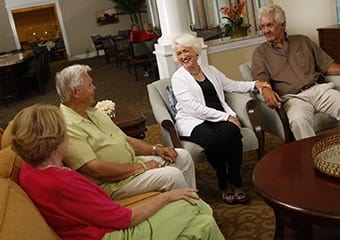 Senior living residents in Florida visiting in lounge.