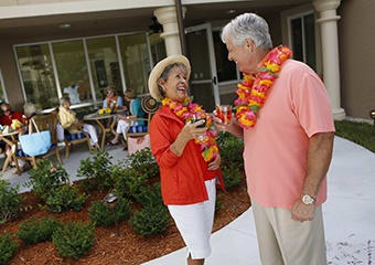 Residents feeling the love with some wine outside at Aston Gardens At Tampa Bay
